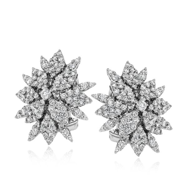 These gorgeous stud earrings take their cues from nature and are covered with 1....