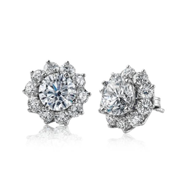 If you want to jazz up a simple pair of diamond studs, try adding these lovely e...