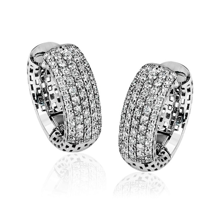 These modern 18k white gold hoop earrings have a rounded shape and a size which ...