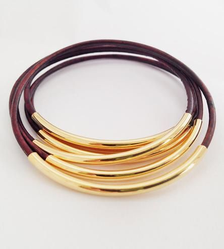 A softer alternative to their metallic counterparts, these leather bangles are s...