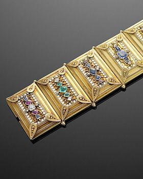 Emerald, ruby, sapphire, diamond and gold archeological revival bracelet.