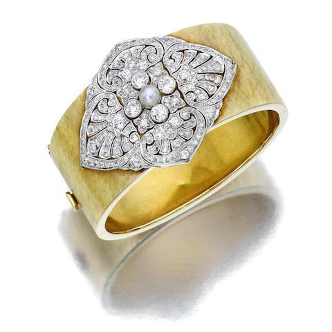 A diamond and cultured pearl bangle bracelet