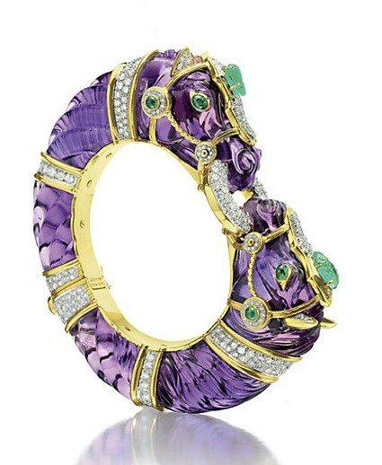 Amethyst, emerald and diamond bangle bracelet by David Webb. The carved amethyst...