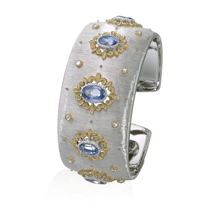 White and yellow gold with oval faceted sapphires and diamonds