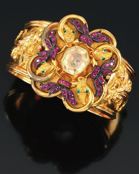 Ruby, emerald, sapphire and gold serpent bracelet, circa 1835.