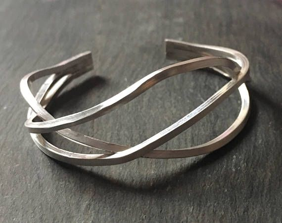 This statement cuff was handmade by me in my little workshop. The triple-band ab...