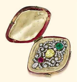 A GEORGE III DIAMOND, EMERALD AND RUBY BROOCH  Shield-shaped scrolling old-cut d...