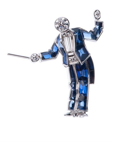 A 'conductor' brooch in platinum with calibrated sapphires and diamonds, by Gime...