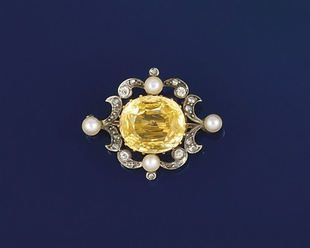 A late 19th century topaz, diamond and pearl brooch. The claw-set cushion-shaped...