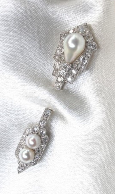 A superbly elegant Art Deco natural pearl, diamond, and platinum jabot brooch, b...