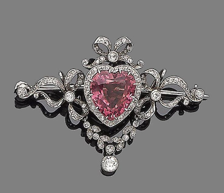 A tourmaline and diamond brooch  The heart-shaped pink tourmaline, within an old...
