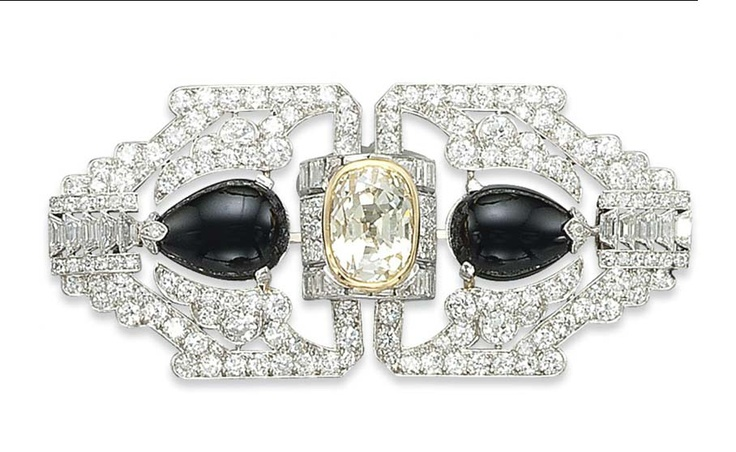 AN ART DECO DIAMOND, COLOURED DIAMOND AND ONYX BROOCH, BY OSTERTAG   Designed as...