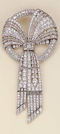 AN ART DECO PLATINUM AND DIAMOND BOW BROOCH, BY HARVEY & GORE LONDON. //// This ...