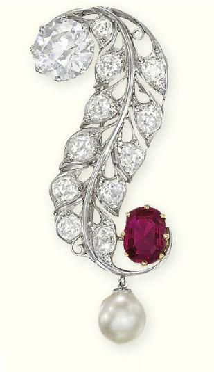 AN EDWARDIAN DIAMOND, PEARL AND RUBY BROOCH Designed as an old-cut diamond folia...