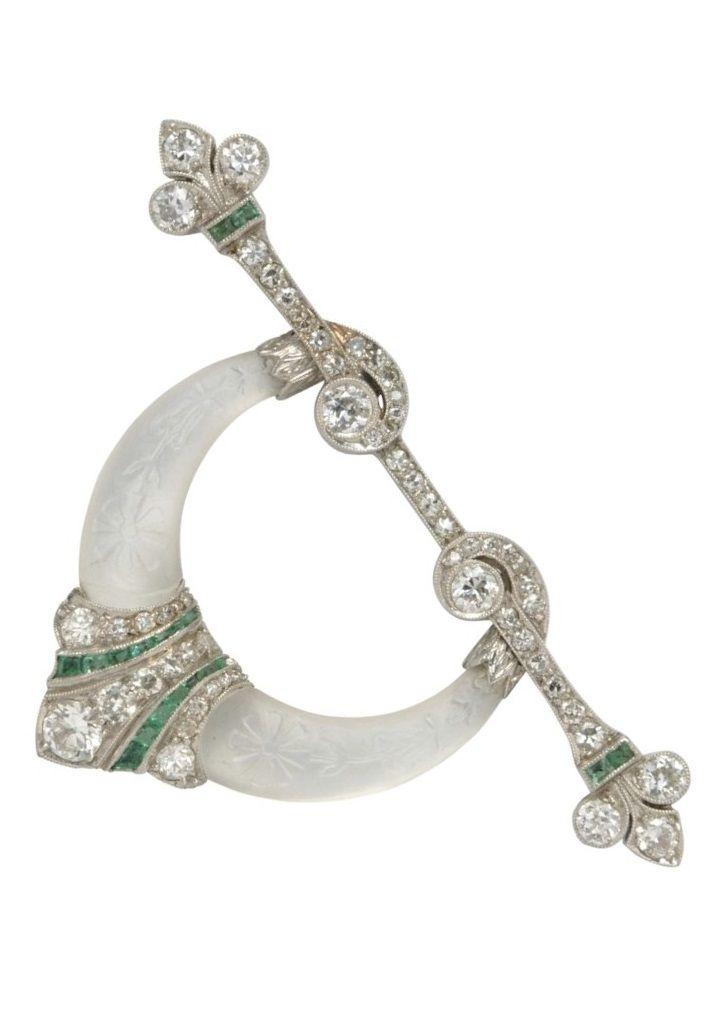 An Art Deco Platinum, Diamond, Emerald, and Rock Crystal Brooch, Spaulding & Co....
