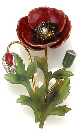 An enamel, nephrite and diamond brooch in the form of a flower; accompanied with...