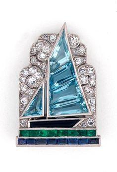 Art Deco diamond and gem-set sailboat clip by Cartier.