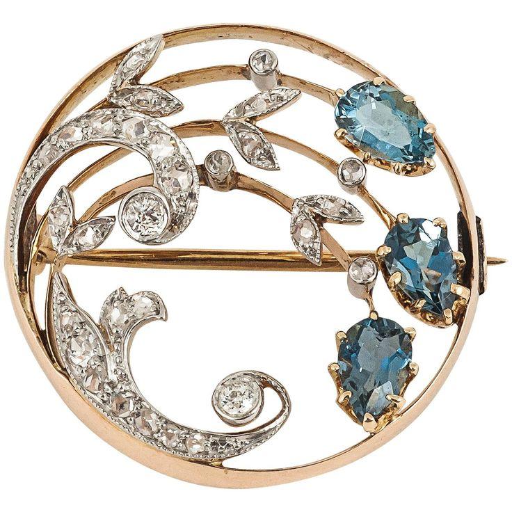 Edwardian Aquamarine Diamond Gold Circle Brooch. A good quality Edwardian period...