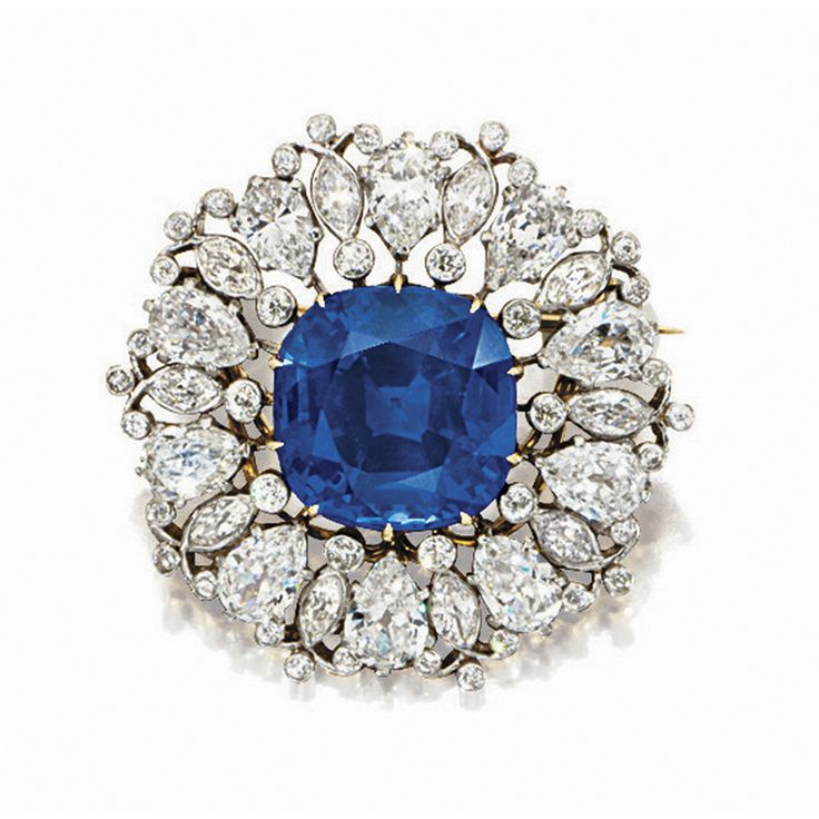 02f500de3 IMPORTANT SAPPHIRE AND DIAMOND BROOCH/PENDANT, TIFFANY & CO. Centring on a  cushi