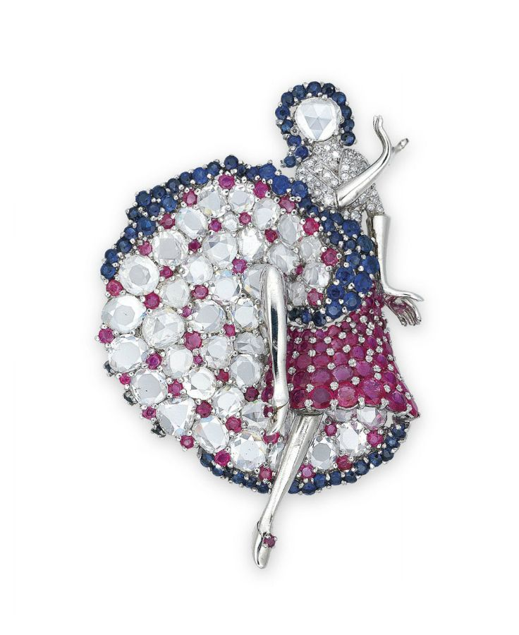 A DIAMOND, SAPPHIRE AND RUBY BROOCH. The dancer designed with a circular rose-cu...