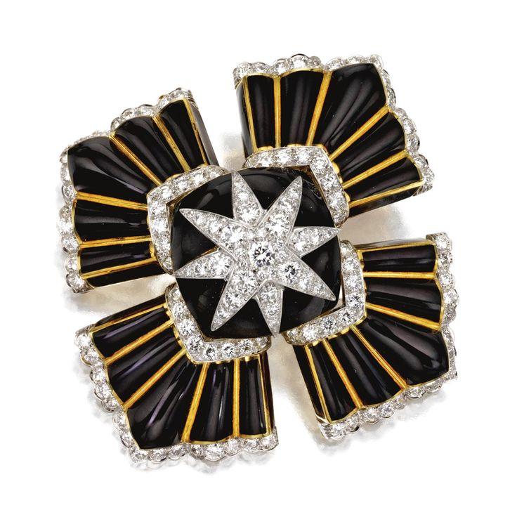 DIAMOND AND BLACK ENAMEL BROOCH, DAVID WEBB The stylized Maltese cross of domed ...