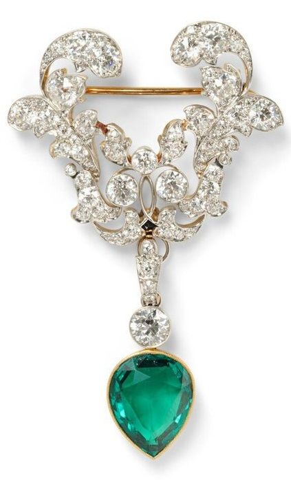 rubies.work/... Edwardian Emerald and Diamond Brooch, the drop set with a pear-s...