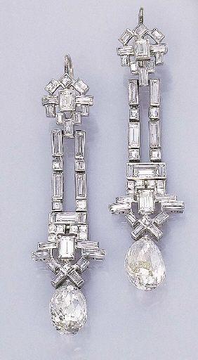 A PAIR OF ART DECO DIAMOND EAR PENDANTS Each designed as a baguette and square-c...