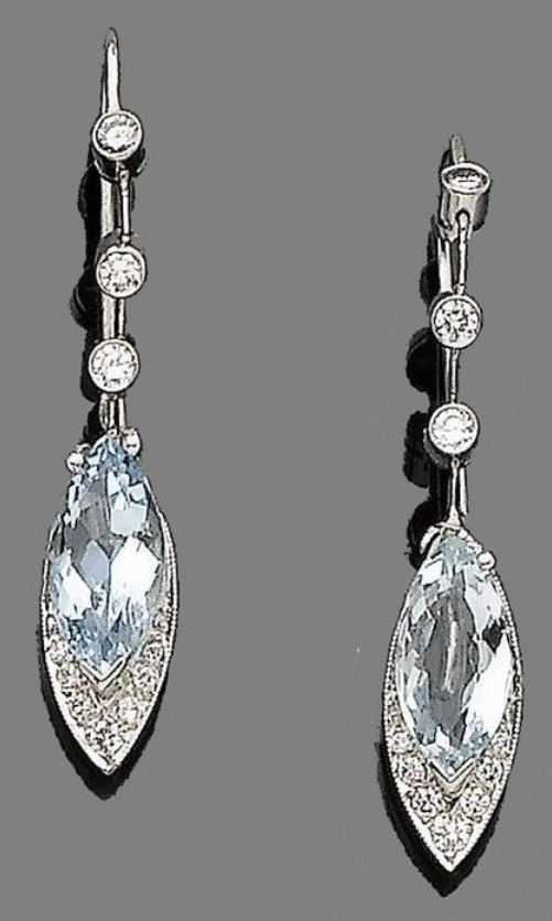 A pair of aquamarine and diamond pendent earrings Each navette-shaped drop set w...