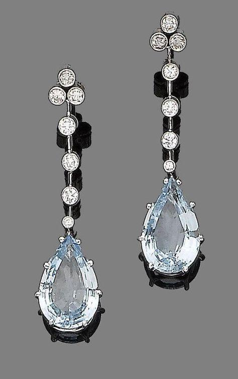 A pair of aquamarine and diamond pendent earrings. Each pear-shaped aquamarine, ...