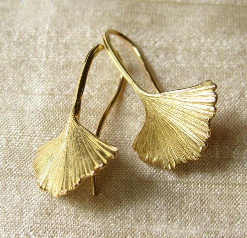Distinctive in their fernlike appearance, ginkgo biloba leaf earrings are cast i...