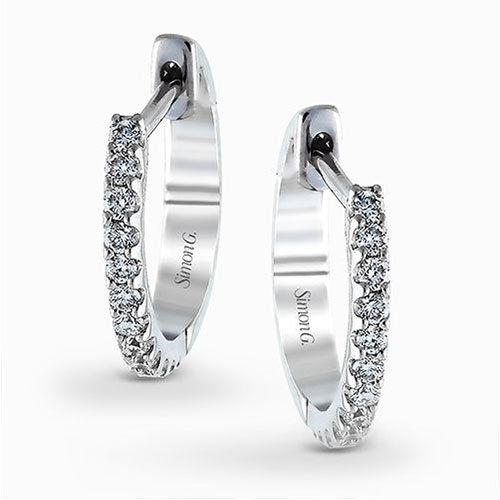 Featuring a classic hoop style with modern accents, these sparkling white gold e...