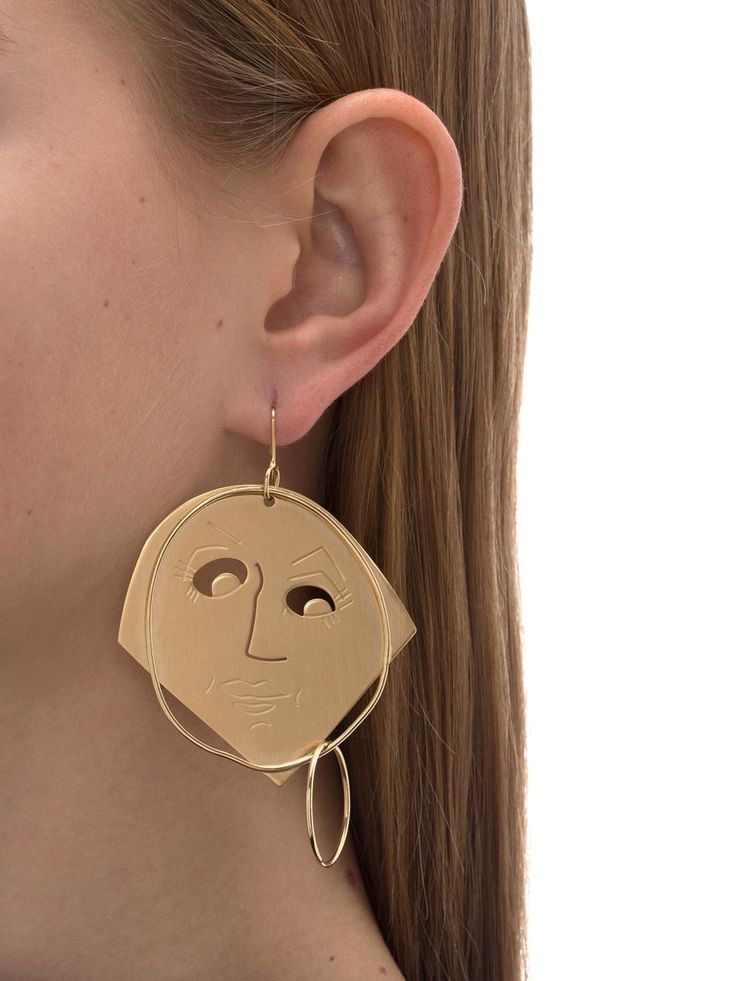 Gold moon face earring by JW Anderson.