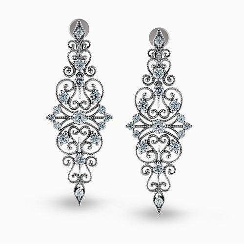 Presenting an intricate vintage style design, these white gold dangle earrings a...