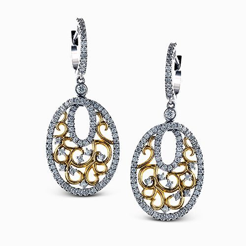 Reflecting a lacy drop design, these vintage style two-tone earrings feature 1.0...