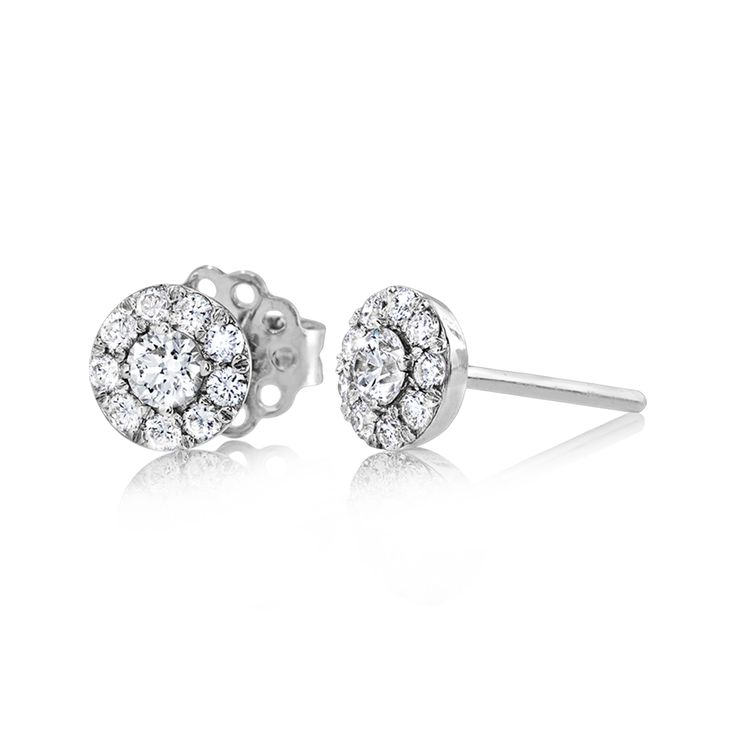 Shining and sparkling, these stud earrings features .24 ctw of center stones sur...