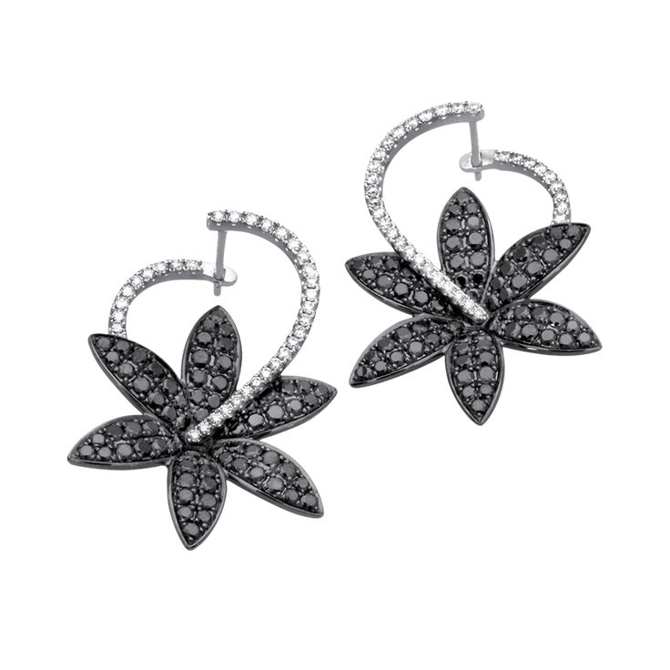 Show off your dark and light sides with these fashionable earrings with 2.49 ctw...