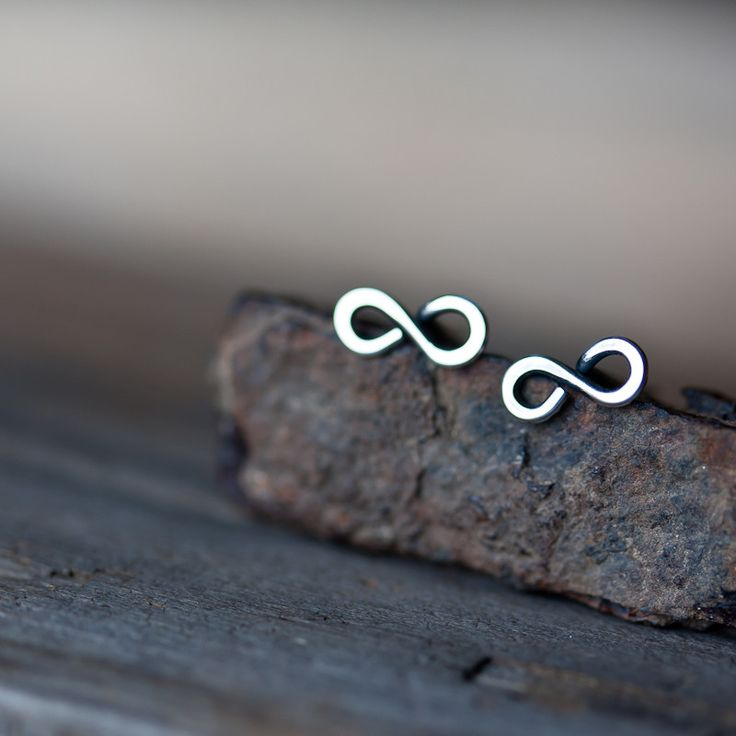 Small and lovingly hand crafted infinity shape earrings formed from continuous l...