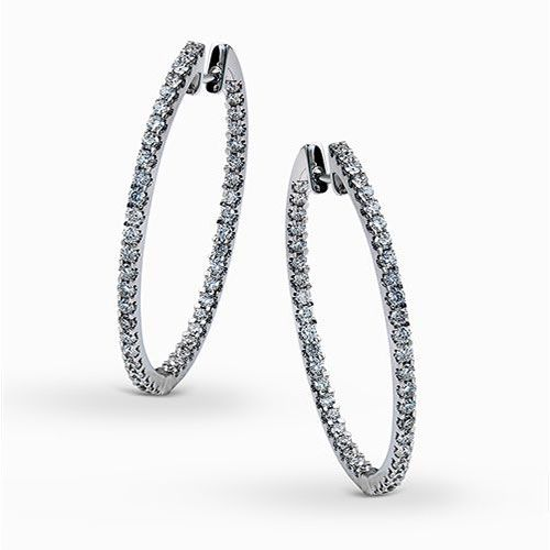 The classic oversized hoop design of these brilliant white gold earrings is emph...