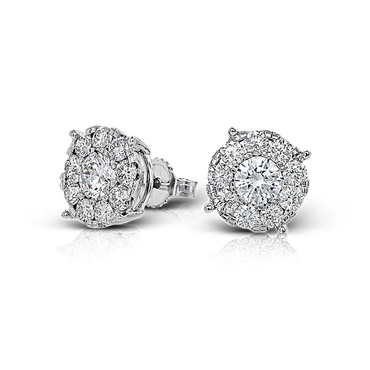 These 18k white gold stud earrings feature .50 ctw diamond centers surrounded by...