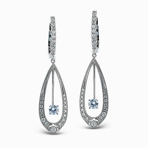 These dramatic white gold dangle earrings feature a lovely teardrop design and a...