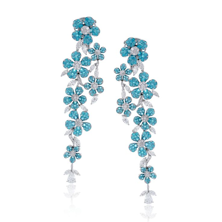 These extraordinary earrings contain 4.42 ctw of bright blue paraiba tourmaline ...