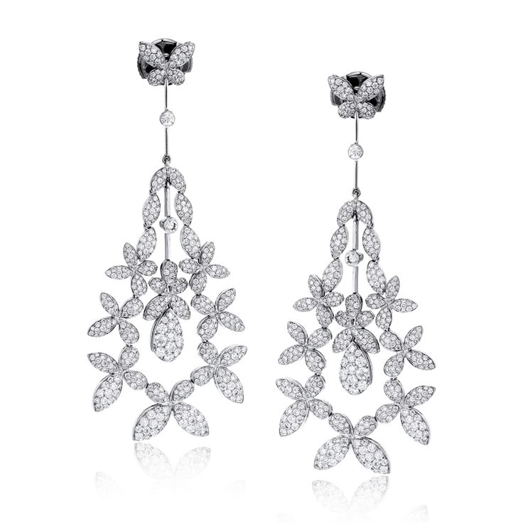 These fantastic floral drop earrings are encrusted with 3.01 ctw of stunning whi...
