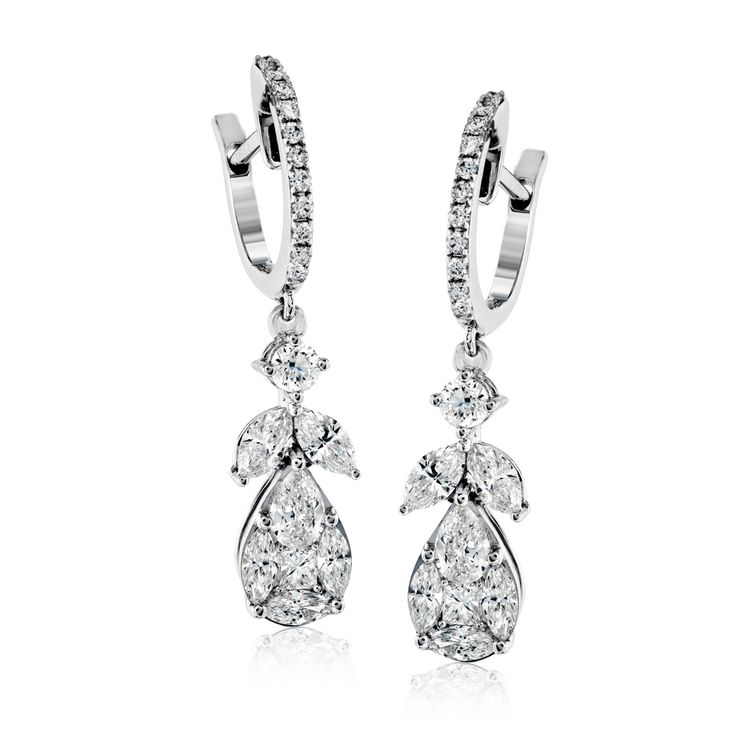 These lovely 18k white gold earrings contain .75 ctw of marquise diamonds, .30 c...