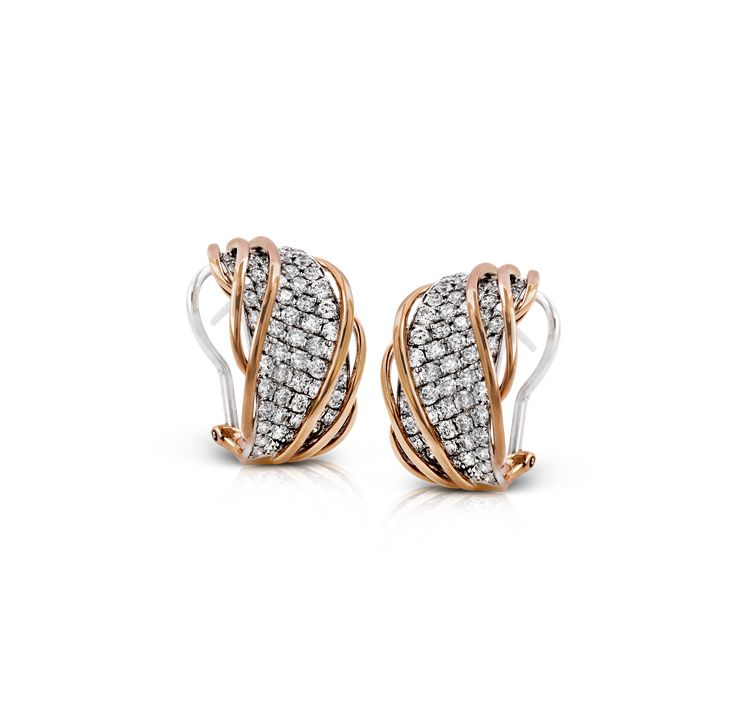 These modern earrings feature an expanse of 2.27 ctw of round diamonds pave set ...