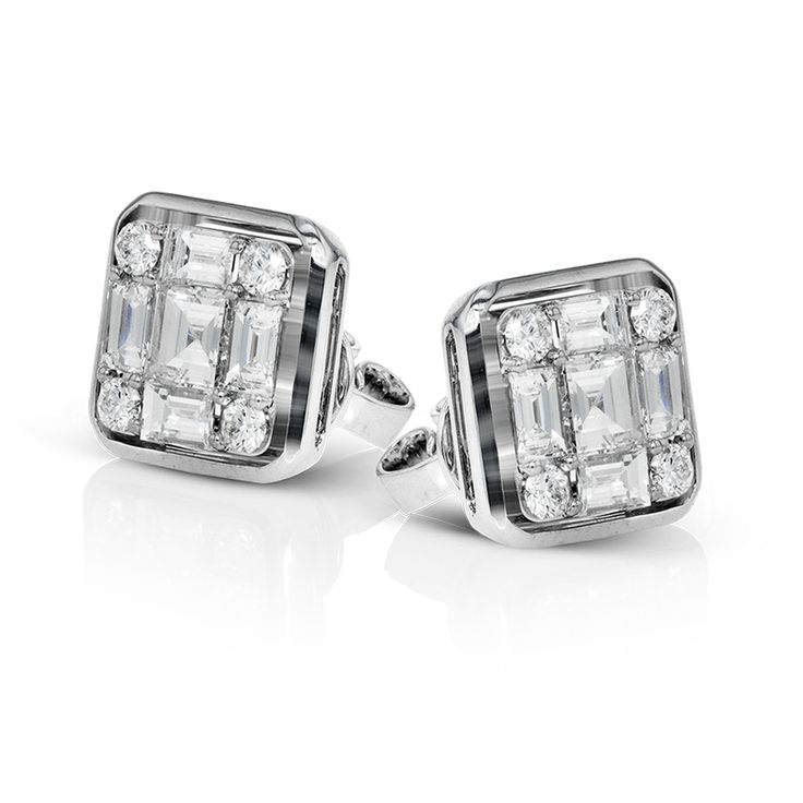 These statement stud earrings are made from 18k white gold and contains 9 smalle...