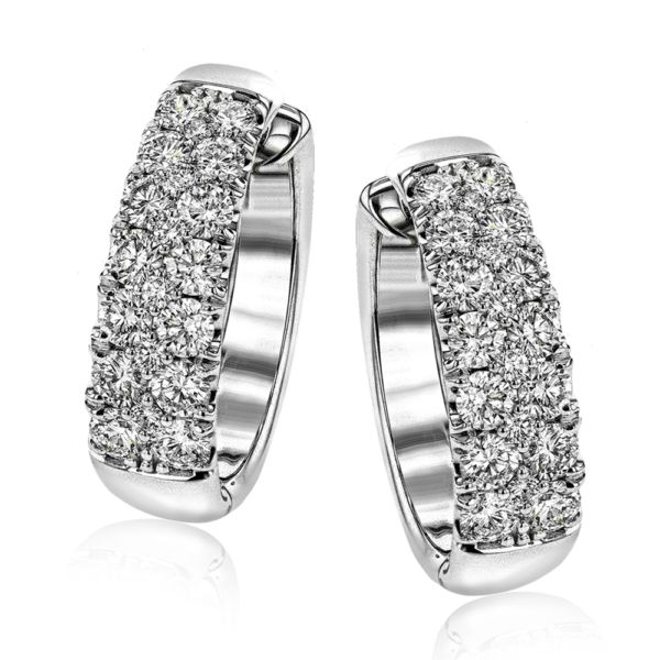 These substantial white gold earrings are the perfect showcase for a stunning 2....