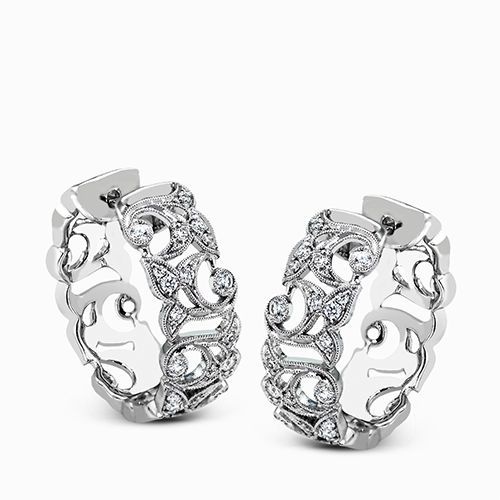 These traditional white gold hoop earrings reflect a romantic floral openwork de...