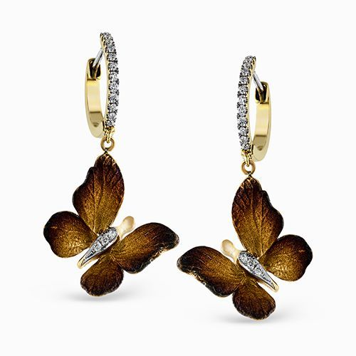 Two lovely golden butterflies are suspended beneath .19 ctw of diamonds, making ...