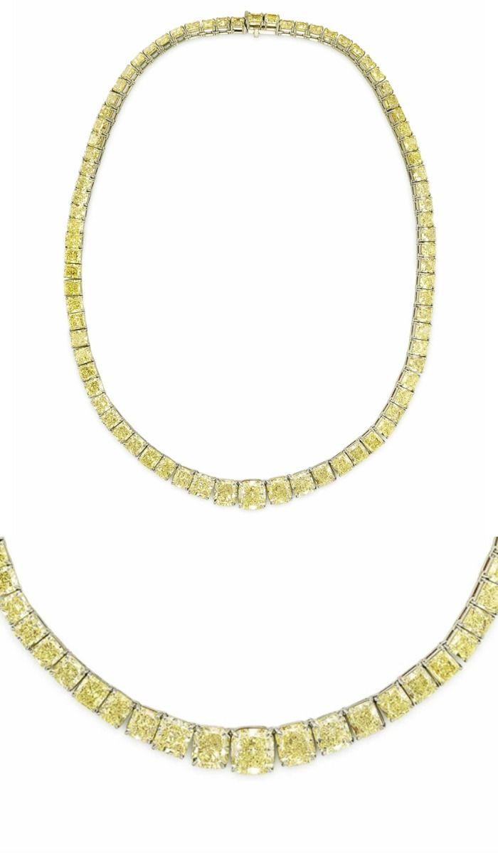 A COLORED DIAMOND NECKLACE:  Designed as a line of 79 graduated cut-cornered squ...