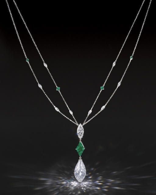 A MAGNIFICENT DIAMOND AND EMERALD PENDENT NECKLACE    Suspending a briolette dia...